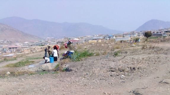 Residents, mostly women in Gimboki queue for water